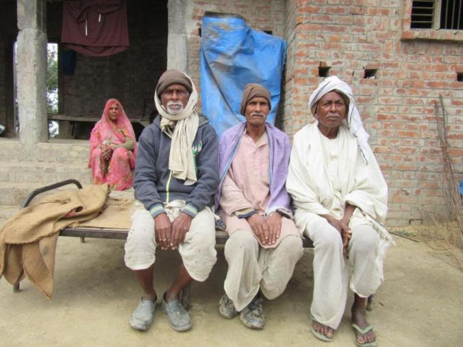 12final-Hare Ram Yadav (middle) and Vasant Chouhan (left) with fellow farmer from Bansgaon
